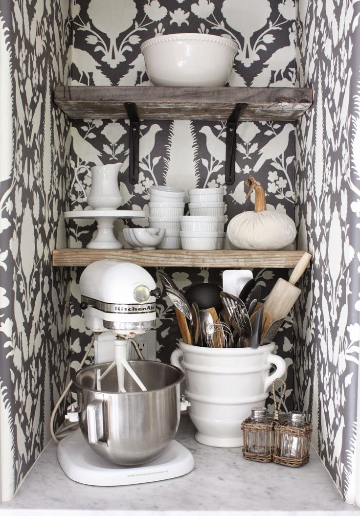 Use wallpaper to decorate one of your kitchen cabinets, change the shelves into something pretty and get rid off the door!
