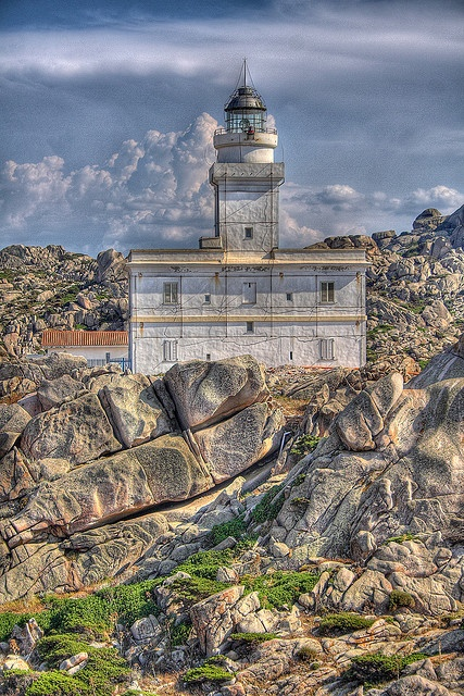 Il Faro Lighthouse, Sardinia, Italy. Go to www.YourTravelVideos.com or just click on photo for home videos and much more on sites like this.