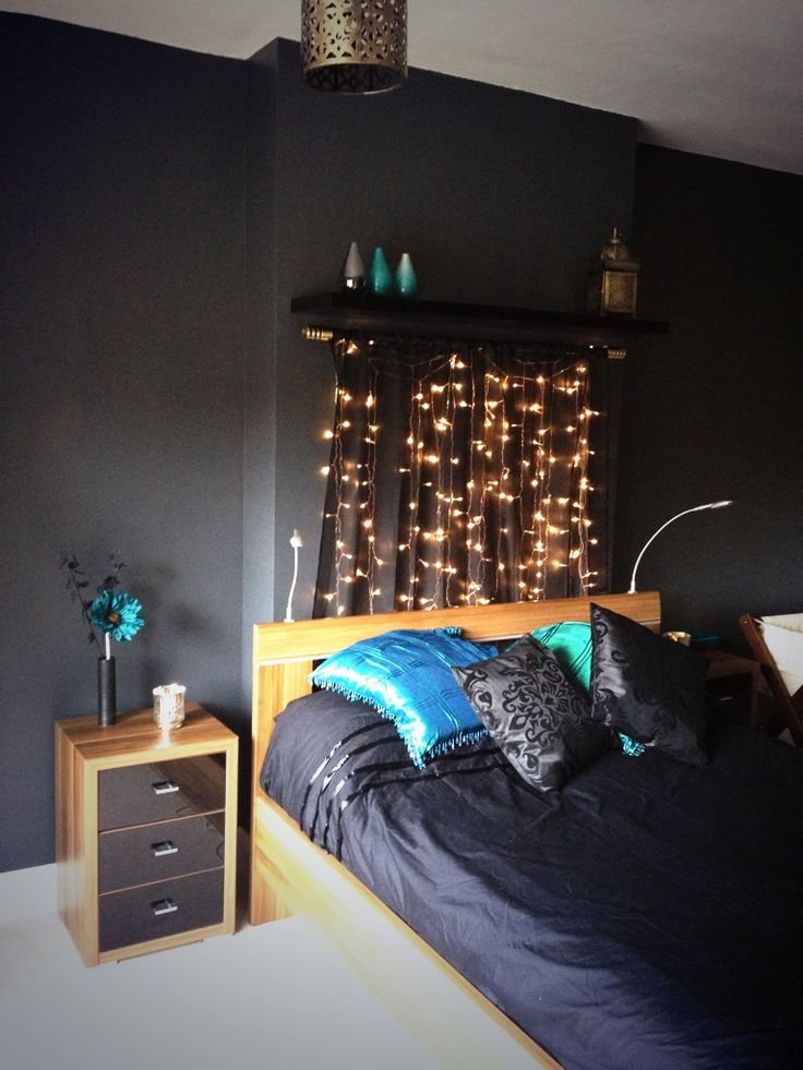 Black, gold and teal bedroom