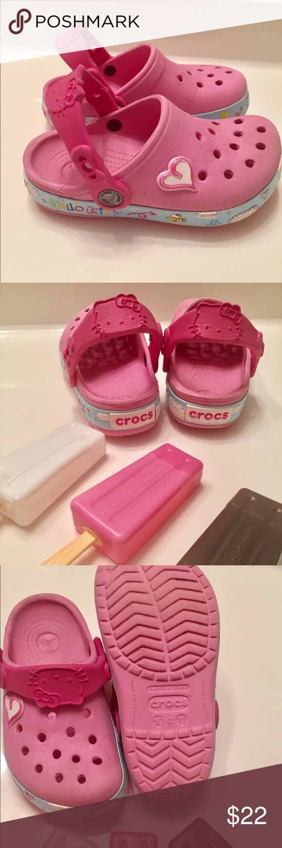 Crocs Hello Kitty (Pink) Hello Kitty Croc Shoes in a light pink and Blue with Hello Kitty Writing Size 10-11 Toddler Gently Used in over all good condition. CROCS Shoes Water Shoes