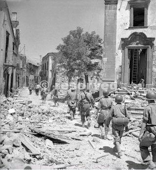 17 August 1943 American troops advance through a damaged street in Randazzo sicily_sicilia word war