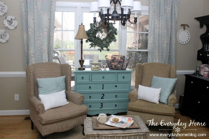 Convert an unused corner into a cozy sitting area with furnishings already on hand.