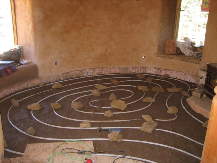 Floor heating. This is a great idea, but I don't see any directions for it on the blog the pin links to.