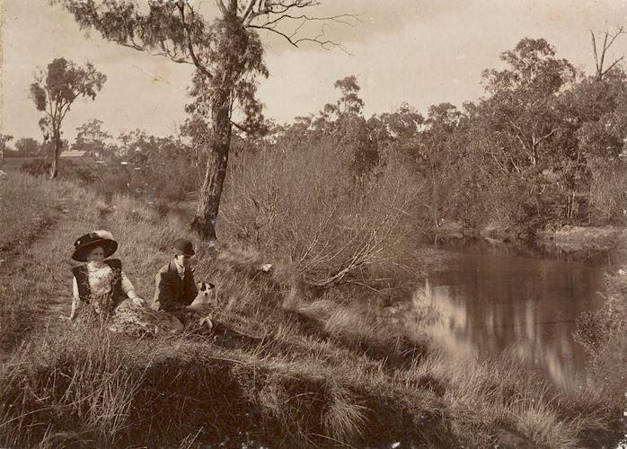 Digital Photograph - Man, Woman & Dog Sitting on Banks of Yarra River, Studley Park, circa 1913