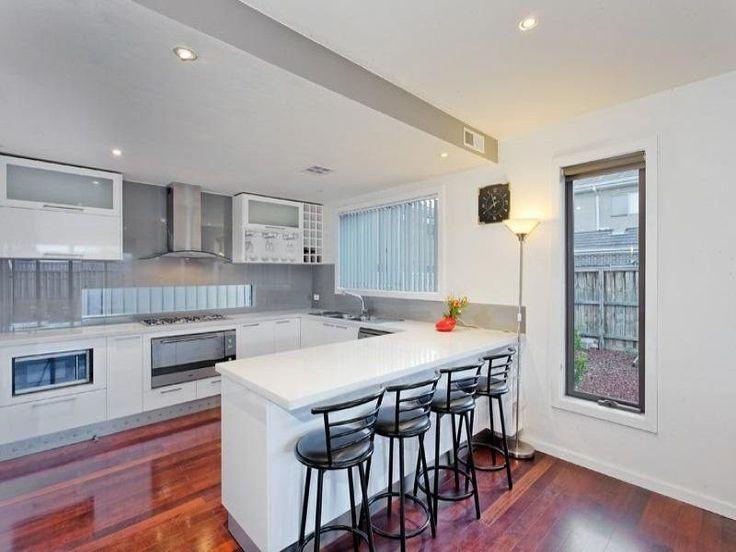 Kitchen with grey splashback