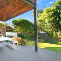 backyard, entertaining area, leafy manicured gardens, BBQ terrace