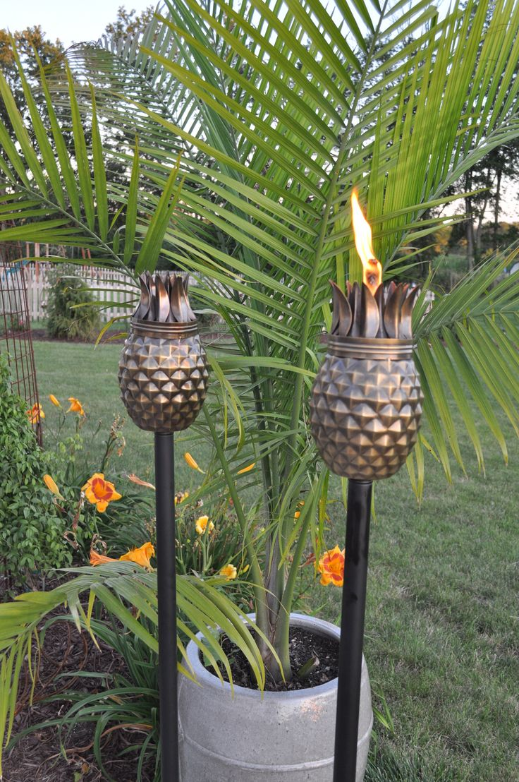Set of 2 Pineapple Vintage Antique Tiki Torches give a tropical weathered feel to your outdoor space. Each torch has an antique vintage finish in a decortive pineapple shape. Each torch head measure 6