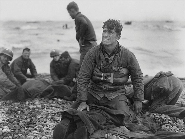 Image: US Army soldiers recover the remains of comrades at Omaha Beach, Normandy, France, in this June 6, 1944 handout photo (© HANDOUT//Reuters)History, 1944, Wwii, Beach Recover, Omaha Beach, Dday, D Day, Wars Ii, American Soldiers