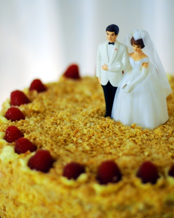A classic Russian Neapolitan cake finished with a vintage cake topper