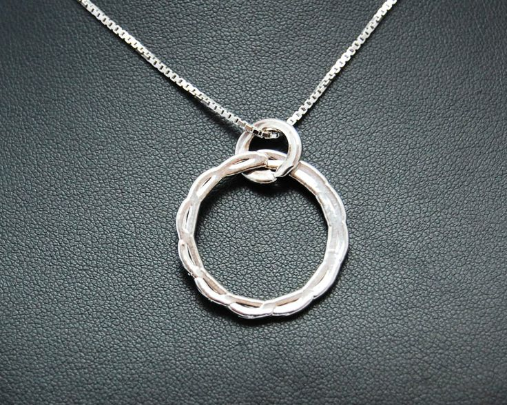 Necklace with a decoration that symbolizes Rome. Electroformed copper, silver plating and rhodium.