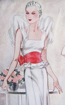 puff sleeves and a red bow. 1930s