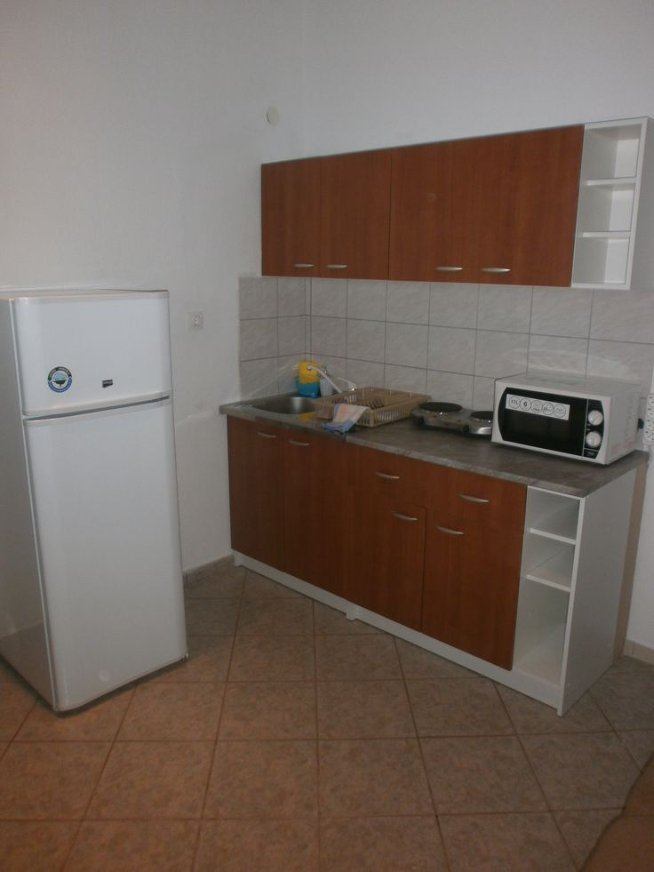 Apartment kitchen with full size fridge