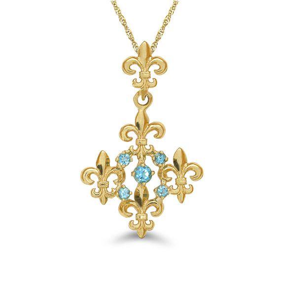 "14k solid gold fleur de lis pendant with genuine blue topaz stones on an 18"" gold chain"