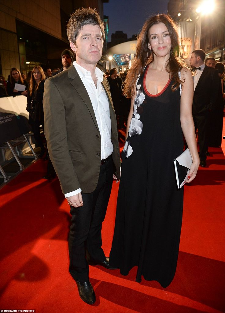 Date night: Noel Gallagher arrived with his wife Sara Macdonald, who wore a baggy floral m...