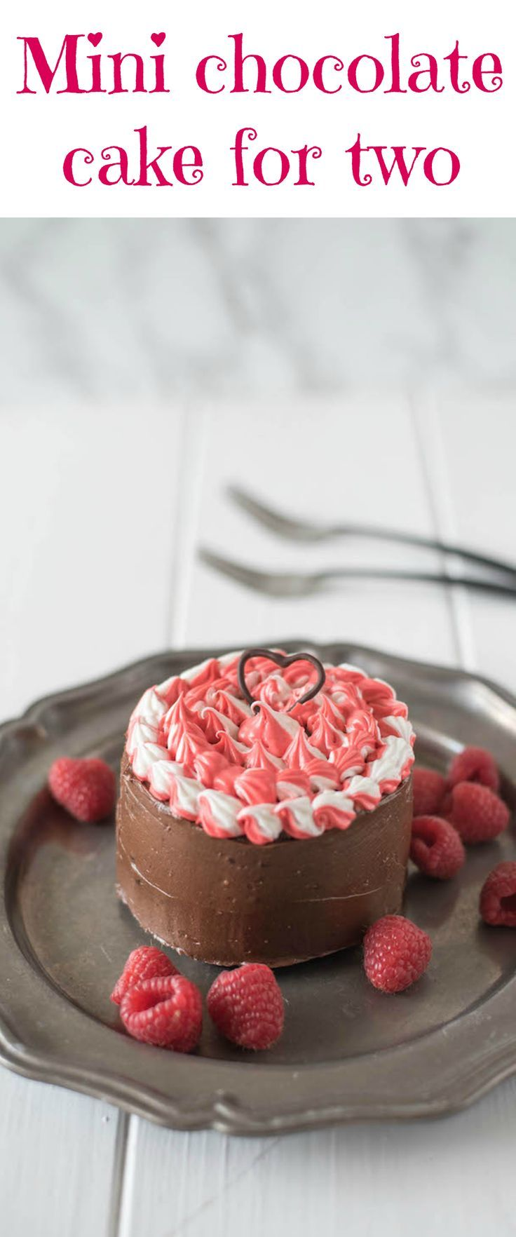 Mini chocolate cake for two is a chocolate lovers dream. Rich chocolate cake is smothered in gorgeous dark chocolate frosting with a little special decorating