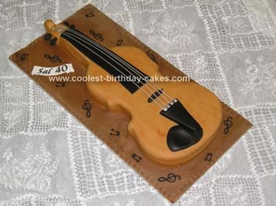 Homemade Violin Cake: I made this Violin Cake for a violin teacher who was 40. I actually had a real violin from which I drew around the shape onto tracing paper then transferred