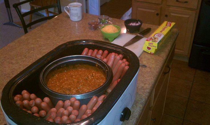 Chili dog bar. My clever husband set a pot of chili in our slow cooker and then stood the hot dogs up around it. Warmed everything up without messing up the stove. Why don't I ever come up with ideas like this?