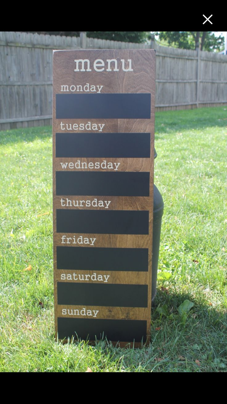 "SIZE: 12"" wide 36"" tall 3"" x 11"" chalkboard space for each day  MATERIAL: (Sample - Stained) Solid and Distressed - 1/2"" MDF Stained - 1/2"" Birch  HOW ITS MADE: Our wooden signs are cut to size, sanded, and hand painted or stained. Custom vinyl lettering is applied for a crisp clear lettering A polyurethane top coat is applied for a long lasting finish and saw tooth hook attached to the back for easy hanging."