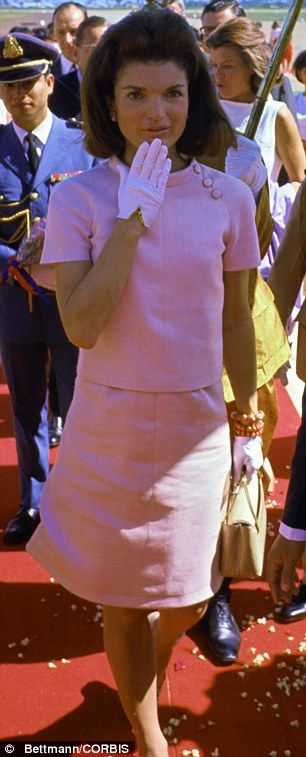 Jacki Kennedy was always elegant in pictures. She also was a fashion icon. Check out the pink gloves.