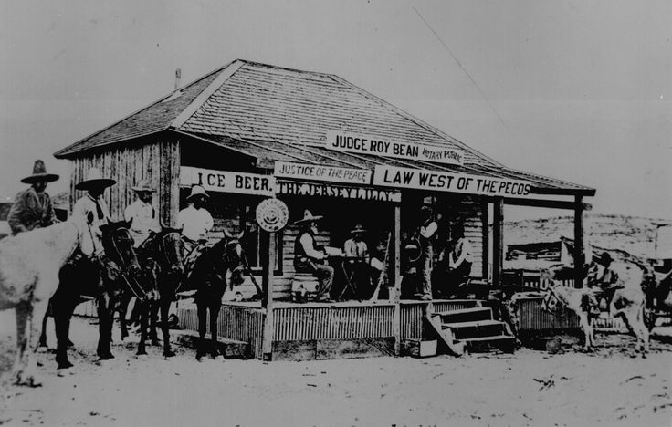Judge Roy Bean, `Law West of the Pecos,' holding court at the old town of Langtry, Texas in 1900, trying a horse thief. This building was courthouse and saloon. No other peace officers in the locality at that time.""