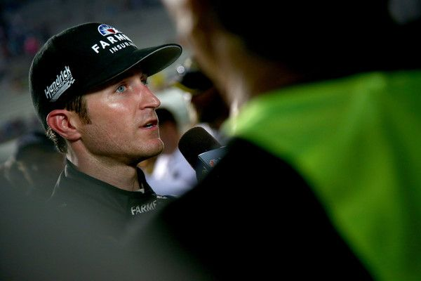 Kasey Kahne Photos Photos - Kasey Kahne, driver of the #5 Farmers Insurance Chevrolet, speaks with the media after the NASCAR Sprint Cup Series Federated Auto Parts 400 at Richmond International Raceway on September 10, 2016 in Richmond, Virginia.