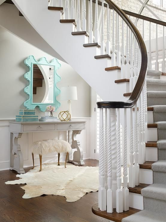 Turquoise Blue and Gray Foyer Under Curved Staircase