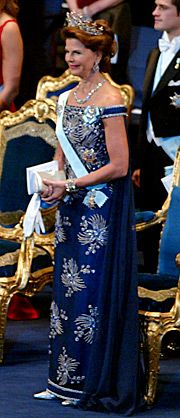 A streamlined evening gown of marine blue silver-embroidered chiffon on a shift of bright blue Thai silk, with a chiffon train. 2002 Nobel Prize Awards Designed by ...