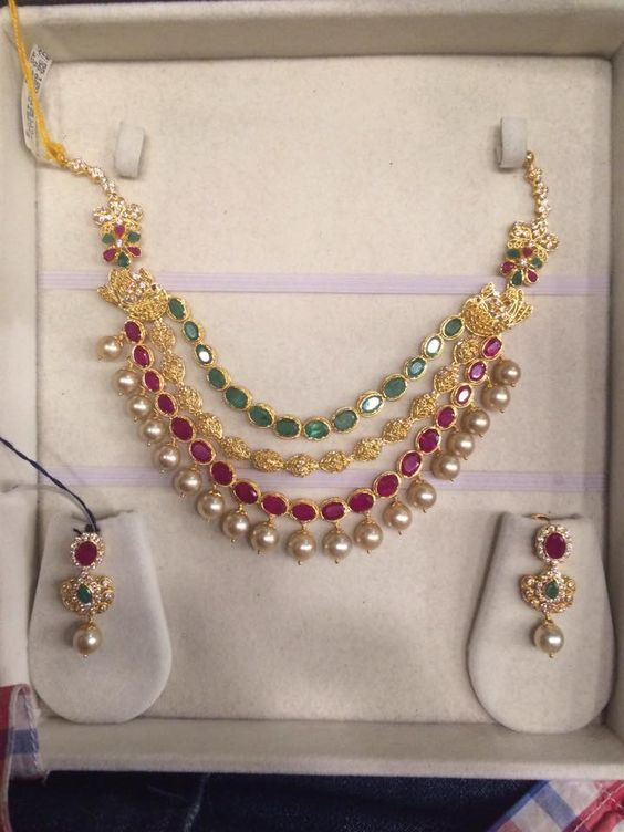Stand out in the crowd wearing this pair of golden colored danglers these danglers are durable and skin friendly. Wear these dan...