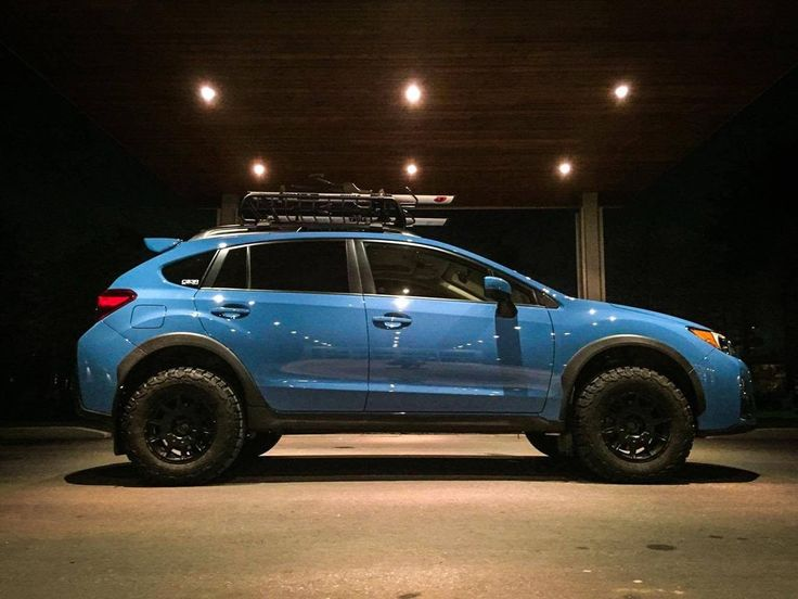 Brand: Subaru Model: CrosstrekYear: 2016Color: Hyper Blue  Modifications: Lift kit: LP Aventure Tires: 215/75R15 BFGoodrich All Terrain T/A KO2Wheels: Method Racing Wheels MR502 VTSpec 15x7 +15Cargo basket: Yakima LoadwarriorBike rack: Thule Sidearm Accessories: Yakima Axe / Shovel bracket    Before the lift kit:  With the lift kit:
