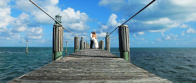 Guests journeyed to the Florida Keys for the refreshing blue waters and alluring sands, but the main reason they were here was to witness the love between Jaimie and Dennis. Islamorada Wedding, Florida Keys, Beach Wedding, Caribbean Beach Resort, flip flop wedding, Just Save The Date