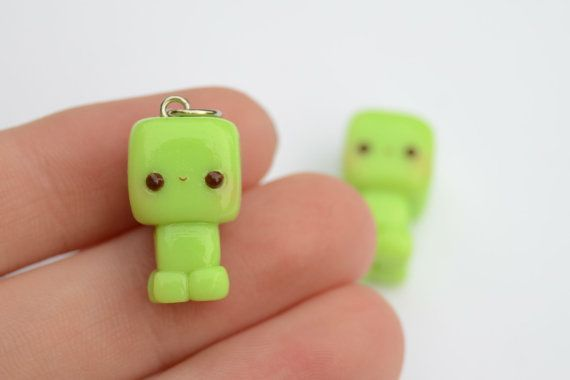 One adorable mincraft creeper charm, handmade out of polymer clay. A jump ring is on the charm so you can put it on your favorite necklace (not: