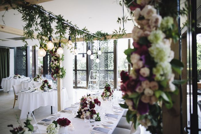 Table arch, wedding, inspiration, flowers, peonies, bridal table, burgundy, red, centrepiece, hanging arrangement, #arch #weddingarch #wedding #styling #weddingflowers, marriage, green, spring Styling by The Style Co, Melbourne, Circa, , shoes, photography by Leo Farrell, venue Circa the Deck St Kilda
