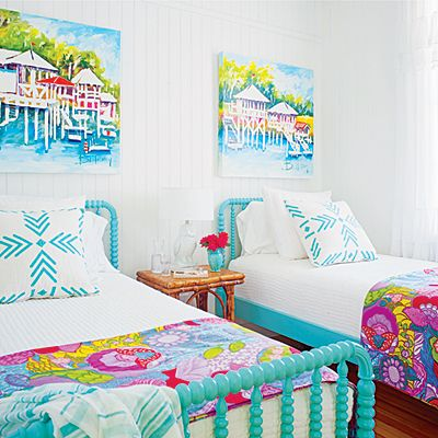 Crisp white walls set a blank slate for this colorful Tybee Island bedroom. | Coastalliving.com