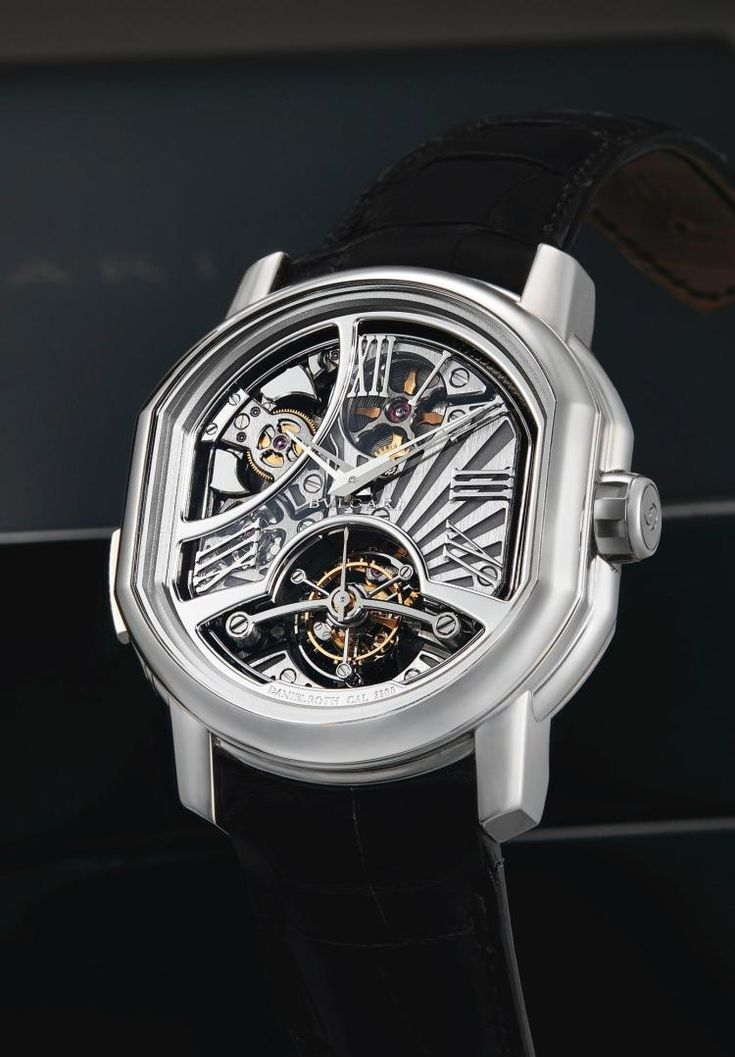 •cal. DR3300 manual winding movement, 35 jewels, one minute revolving three arm tourbillon carriage, twin barrels, carillon minute repeating on 3 hammers • semi-skeletonizeddial, applied Roman numerals, aperturewith three concentric 20 second scales for one-minute tourbillon, aperture revealing repeating mechanism • 18k whitegold tonneau-shapecase, repeating slide to the left band, crown engraved with limited edition number, sapphire crystal display back secured by 6 screws • <em>case…