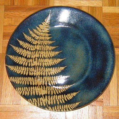Fern leaf designdesign dinner plates. http://ronrothman.com/public/albums/interesting-plates/fern_plate_kaleidoscope_pottery.jpg