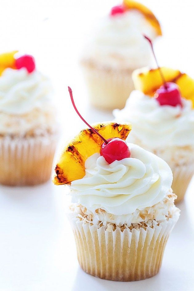 I lile the grilled pineapple and frosting for this one Pina Colada Cupcakes _ Bakers Royale