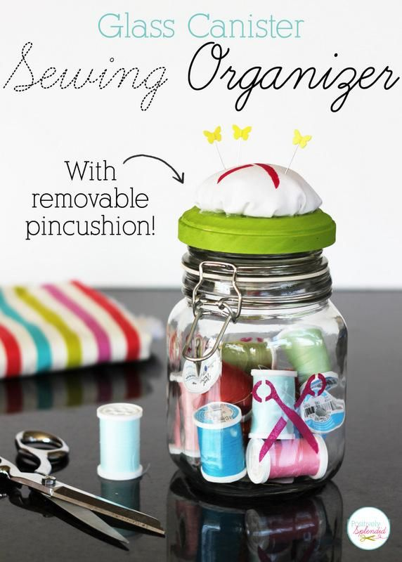 Glass canister sewing organizer with removable pincushion at Positively Splendid.