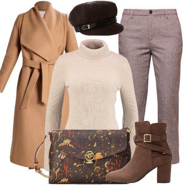 Un cappotto beige, un paio di jeans con stampe e un maglione