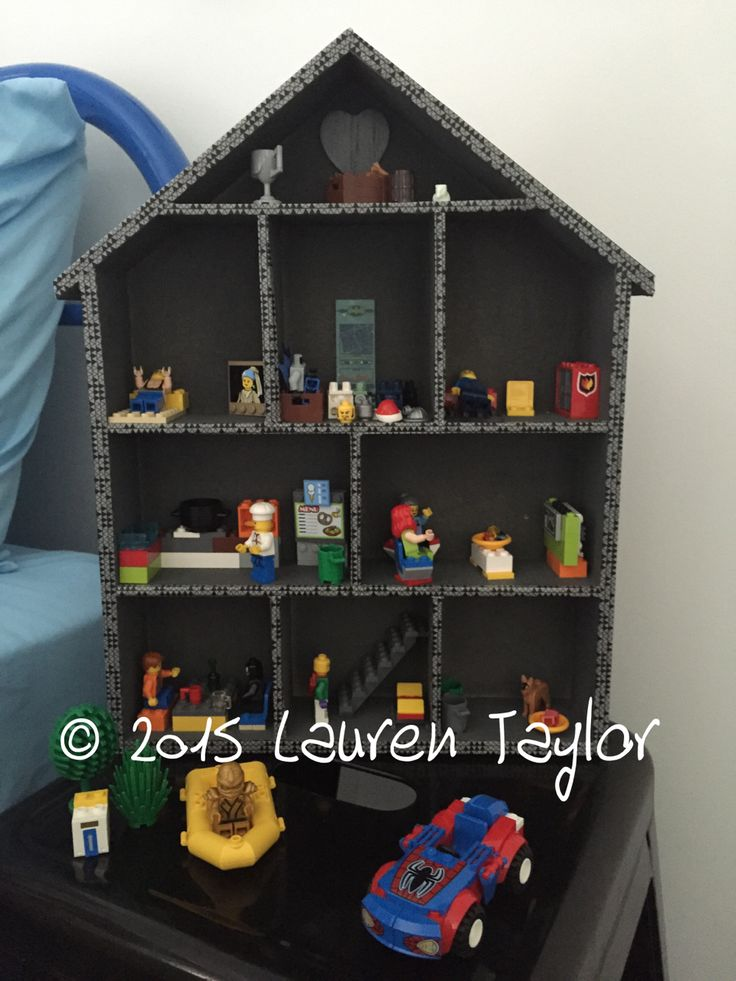 Lego playhouse / storage / hack / DIY - made with kmart shelf house, grey spray paint and geometric washi tape. Which makes a great boys doll house.