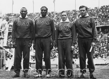 At the1936 Berlin Olympics, African American track star Jesse Owens (Far Left w/Ralph Metcalfe, Foy Draper & Frank Wykoff)) wins his fourth gold medal of the Games in the 4x100-meter relay. His relay team set a new world record of 39.8 seconds, which held for 20 years. Jesse Owens & other African American athletes struck a propaganda blow against Nazi leader Adolf Hitler, who planned to use the Berlin Games as a showcase of supposed Aryan superiority.