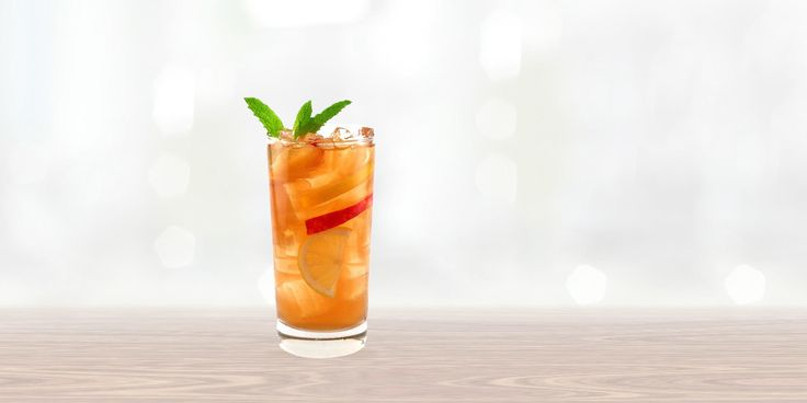 The Peach Fuzz with SMIRNOFF® Peach 1.5 oz Smirnoff Peach 2 oz lemonade 1 oz ice tea .5  oz simple syrup 2 mint leaves combine all ingredients in an ice filled shaker, shake well, strain into an ice filled glass, garnish with lemon slices and mint.