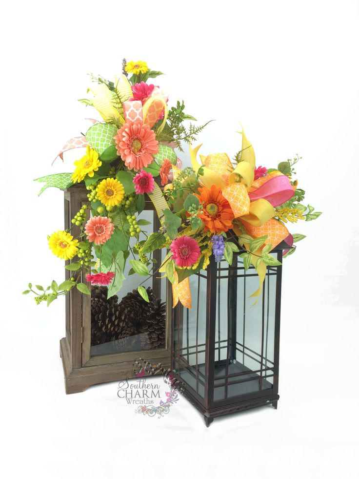 A pair of spring lantern swags in the bright colors of orange, yellow and pink. I love to decorate for spring! Designs by www.southerncharmwreaths.com