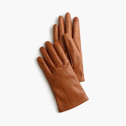 These leather gloves are lined completely in cashmere and tipped with touchscreen technology in the fingers—because texting a friend to meet up for cocoa shouldn't involve frostbite. <ul><li>Leather.</li><li>Cashmere lining.</li><li>Import.</li></ul>