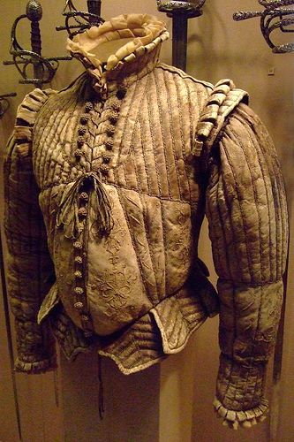 Fencing Doublet featuring a protruding peascod waist Western European about 1580 CE Leather silk linen cotton by mharrsch, via Flickr - in Met Museum