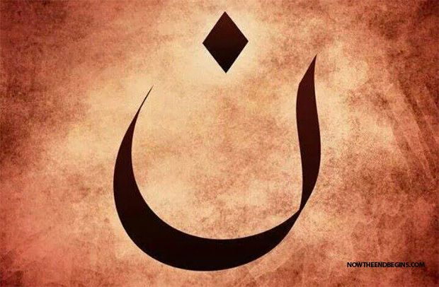 "As the Christians leave Mosul, ISIS has painted the Arabic letter that means ""Nasrani,"" from Nazarene, a word often used to refer to Christians, on their homes. Next to the letter, in black, are the words, ""Property of the Islamic State of Iraq."""