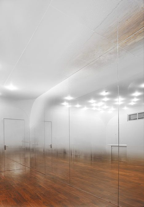 Beijing based architects Tsutsumi and Associates have completed this dance studio in Beijing with mirrored walls covered in tiny graduated dots to create the illusion of a mist hanging in the air.