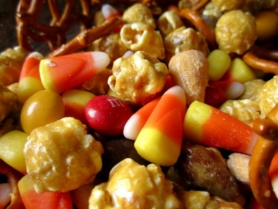 2 cups caramel corn    ½ cup candy corn    ½ cup peanut butter M&Ms    2 oz. salted pretzels    2 oz. salted nuts
