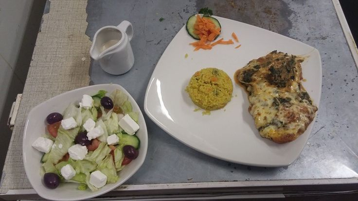 Our Pollo Parmigiano with a side of rice and a side salad...