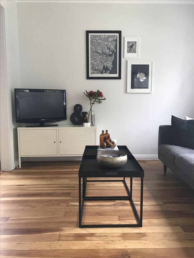 Typography print, warm native timber flooring, excellent natural light, and streamlined black side tables grouped together to make a coffee table work together to make a small space seem sophisticated and much larger than it is. Shout out to the ever popular and classic IKEA PS cabinet! An eternal fave.