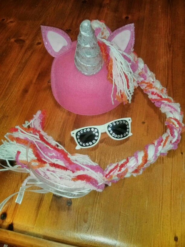Thelma the Unicorn DIY dress up for Book Week 2015. Paper mache covered polystyrene cone for horn, with felt ears and plaited mane on a felt hat. With a touch of glitter and bling on the sun glasses!